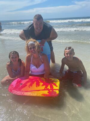 Kristin Fox and her family at the beach